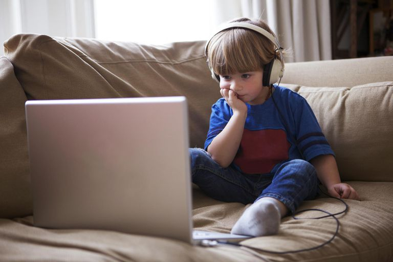 Little boy watching videos on a laptop