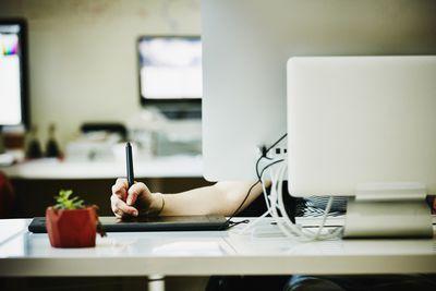 Designer drawing on tablet