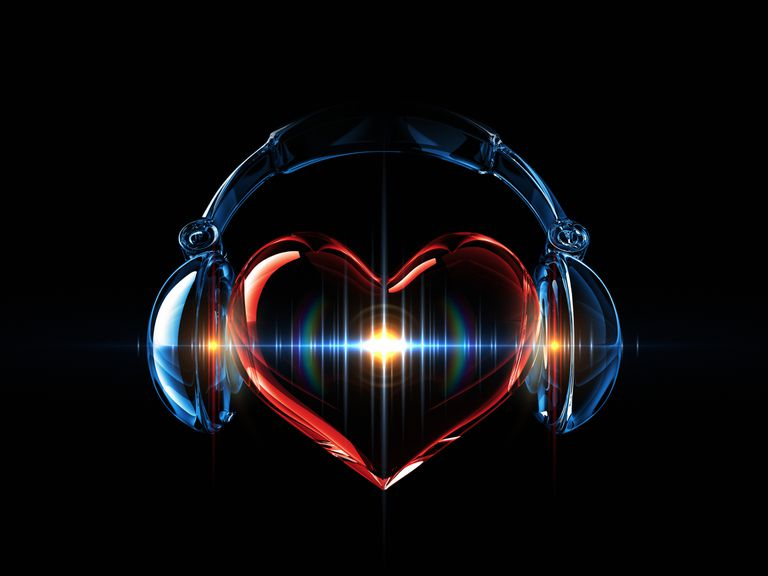 Neon heart and headphones on black background