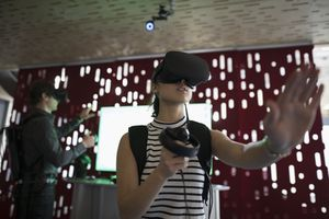 Woman playing a VR game with VR headset on