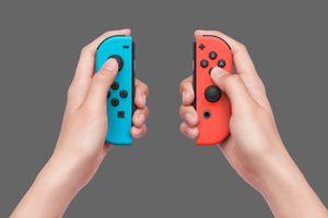 Hands holding Nintendo Joy-Cons