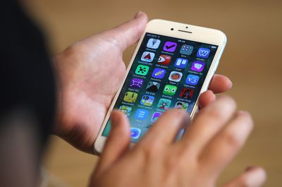 close-up of hand moving iPhone apps