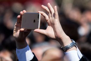 An iPhone being used to snap photos
