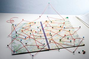 map with pins and yarn stuck in it