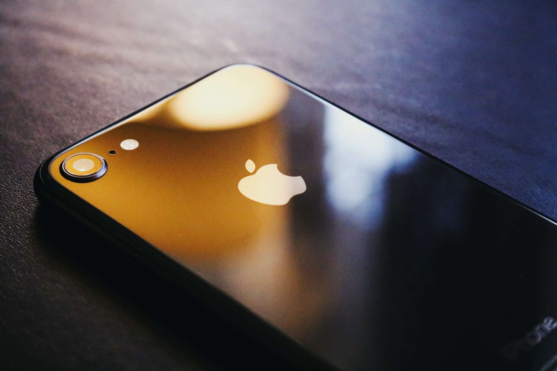 Apple iPhone face down on a surface