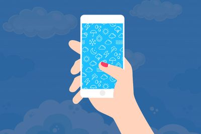 Illustration of a woman holding a phone with a weather background