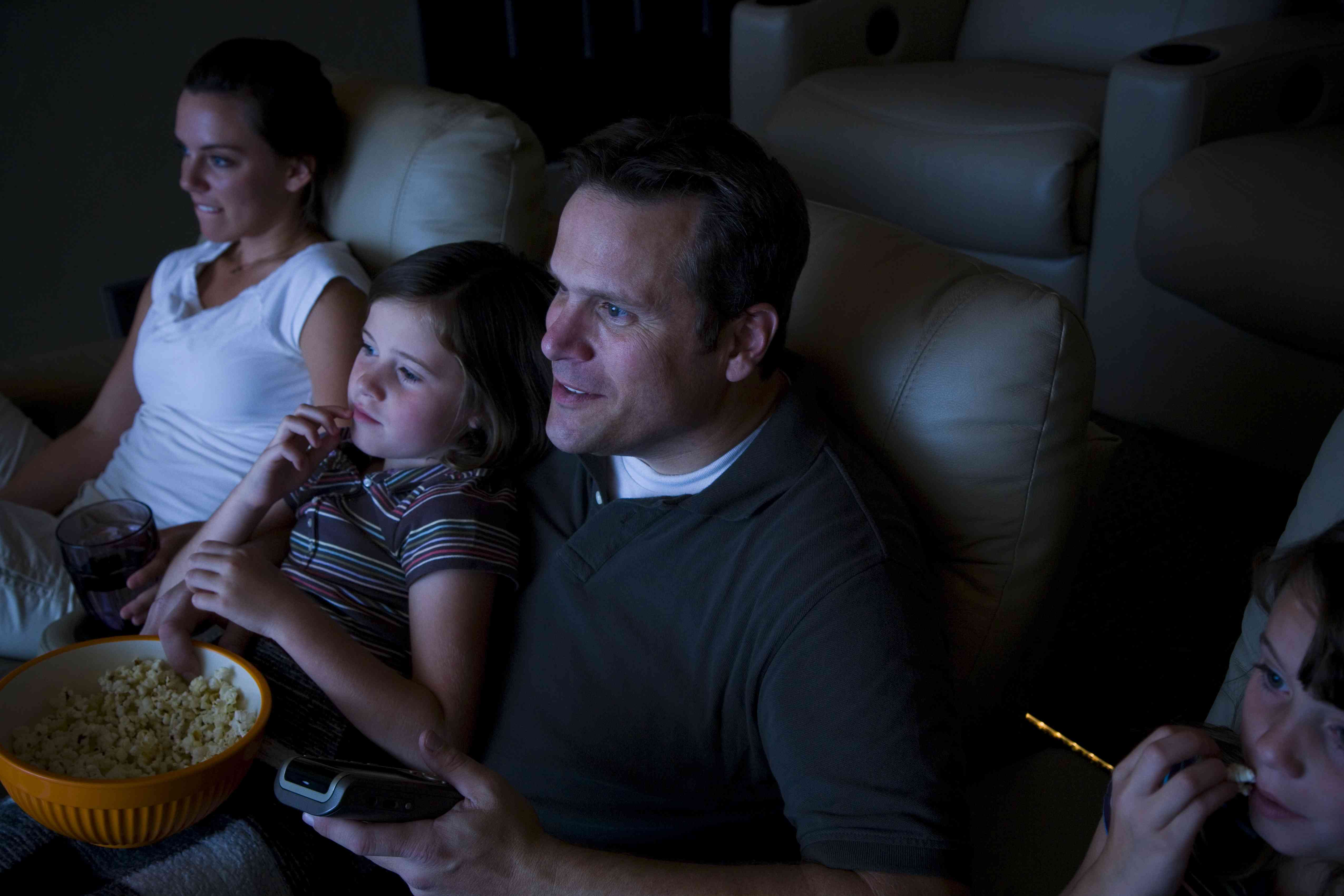 People watching a movie in their home theater
