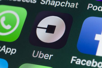 Uber logo on phone screen depicting an uber account that will be deleted