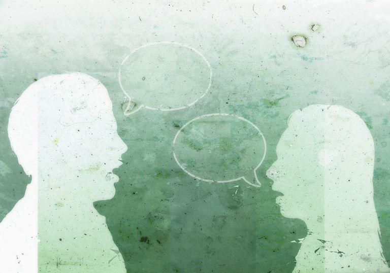 A man with an empty speech bubble facing a woman with an empty speech bubble