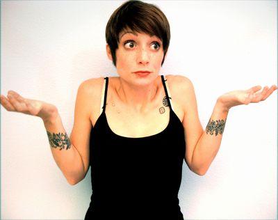 A girl shrugging her shoulders