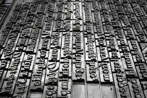 Metal typeface lined up into sentences