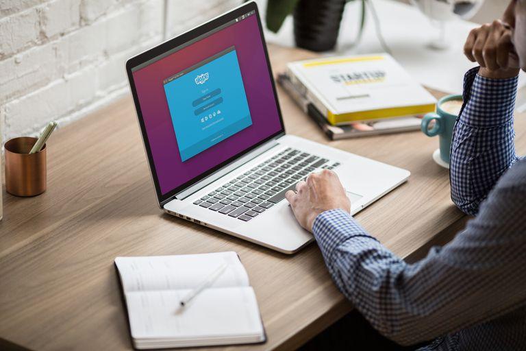 Man looks at Skype app on computer