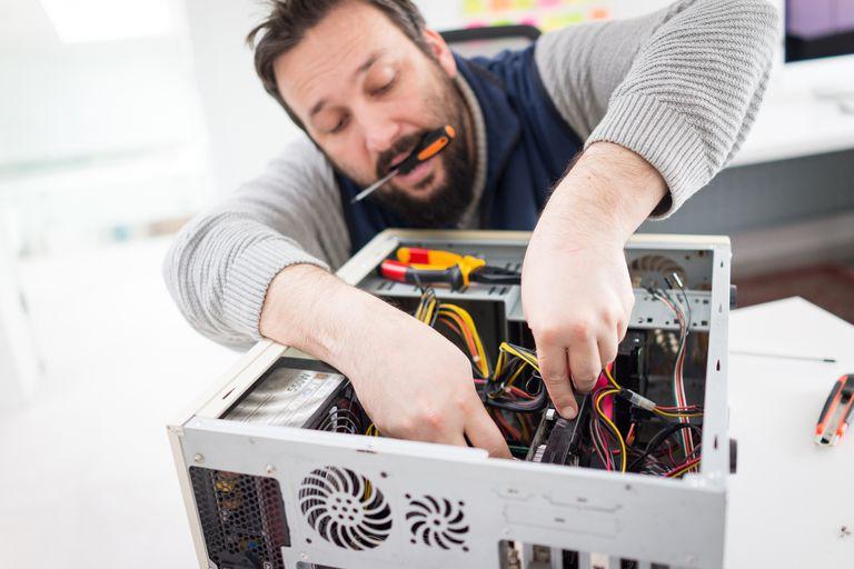 Man repairing desktop computer