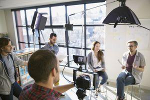 Business people shooting video tutorial