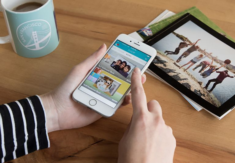 Snapfish user making photo book on snapfish app