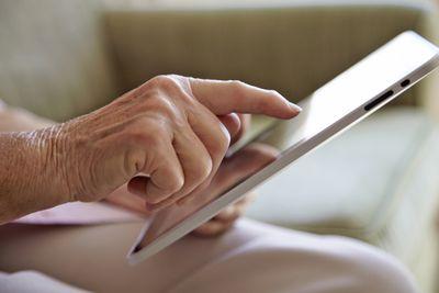 A senior using a tablet