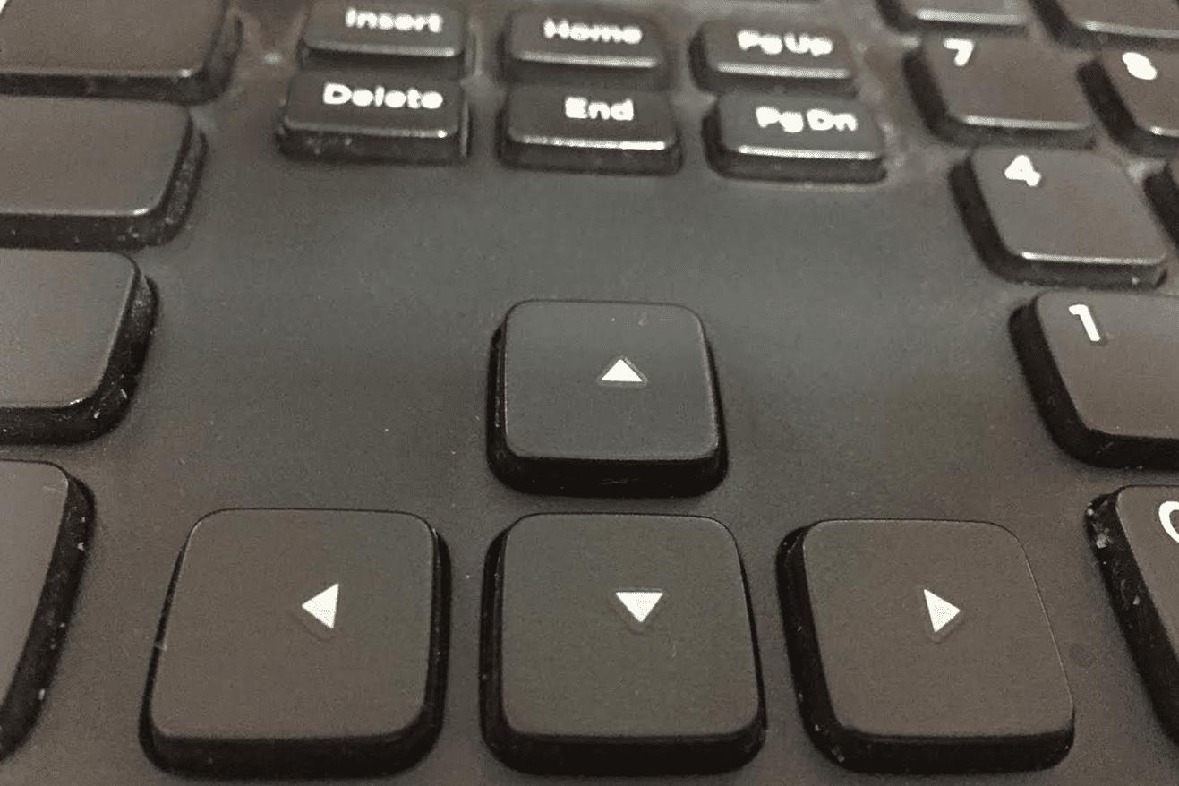 Photo of arrow keys on a black keyboard