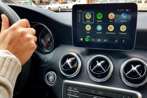 Apple CarPlay displayed on an infotainment system in a car.