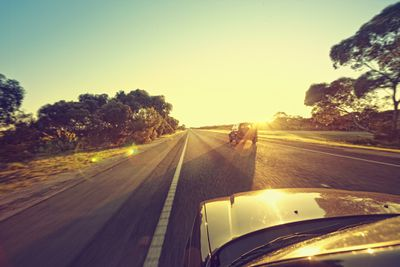 Car on the open road during sunset