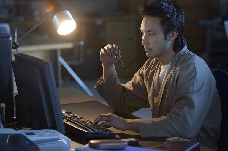 Businessperson typing on computer