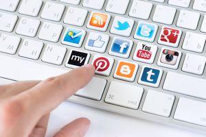 An image of social media icons on computer keyboard keys.