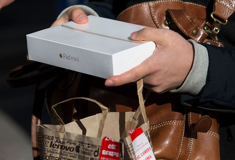 Shopper holding iPad mini box