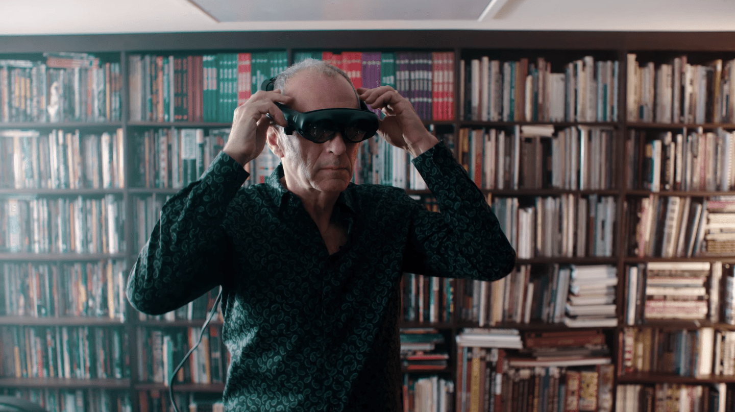 A man putting a Magic Leap One headset on.