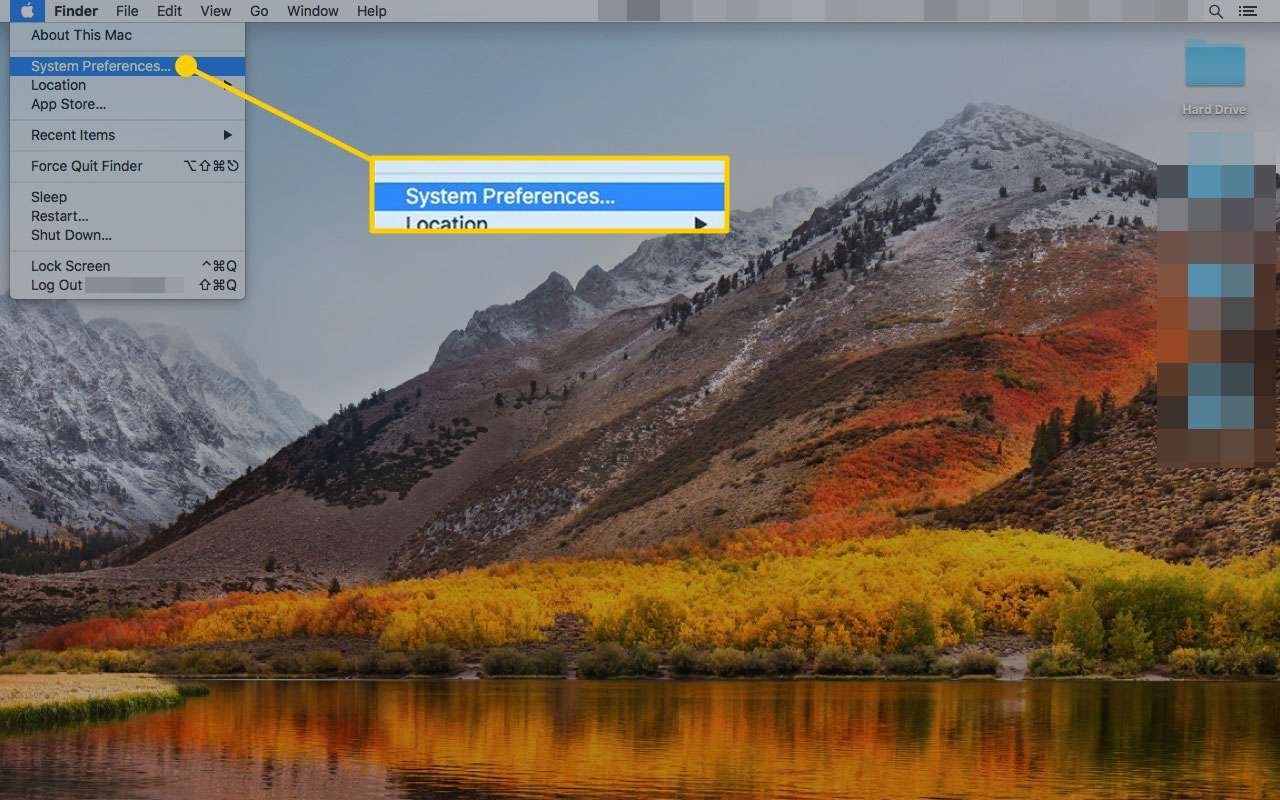 A Mac desktop with System Preferences highlighted