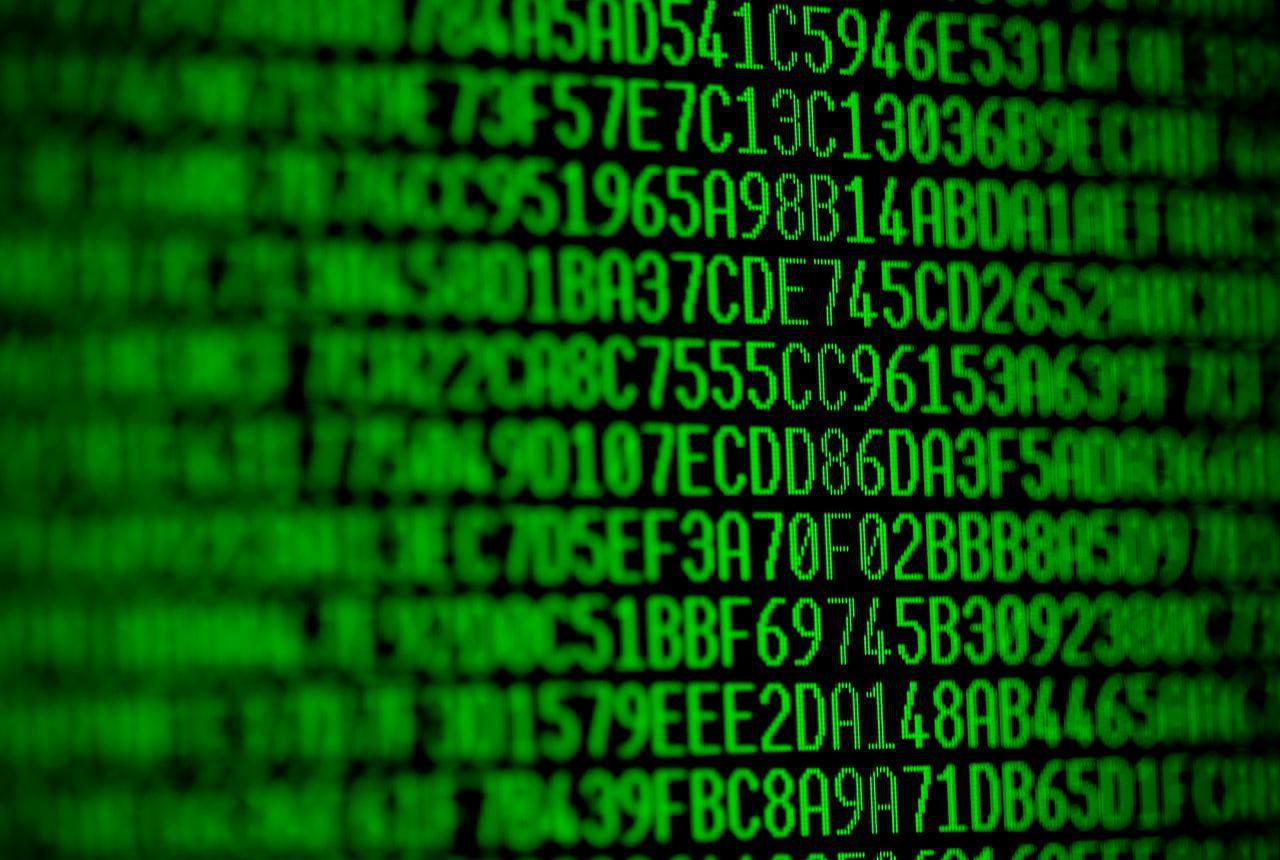 random green hexadecimal codes on a computer monitor