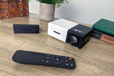 A projector with a Fire TV Stick