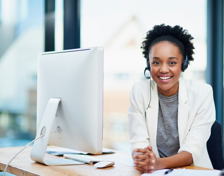 African American customer service representative at computer