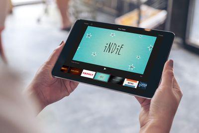 A woman using iMovie on an iPad