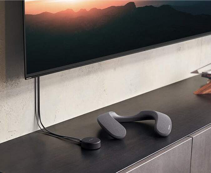 Sony neckband speaker resting near a TV