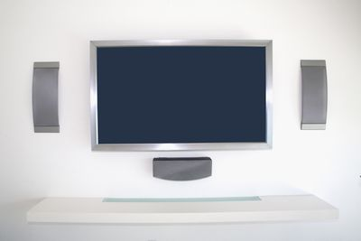 Home theater setup with in-wall speakers.