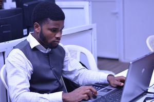 Man working on laptop in business setting