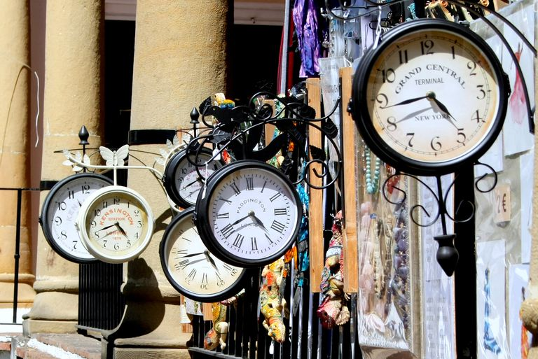 Six clocks hanging next to each other