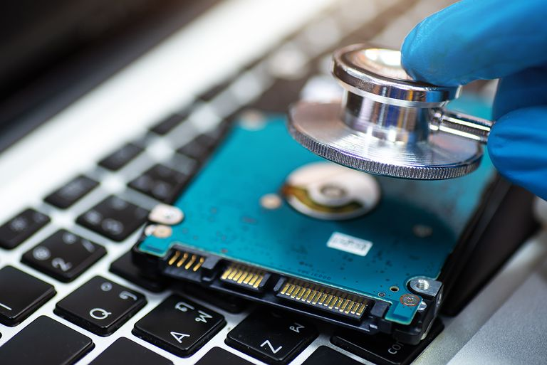 Close-up of stethoscope on laptop and Hard Disk, repair concept