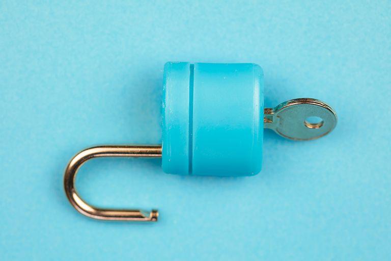 Blue padlock with key on blue background