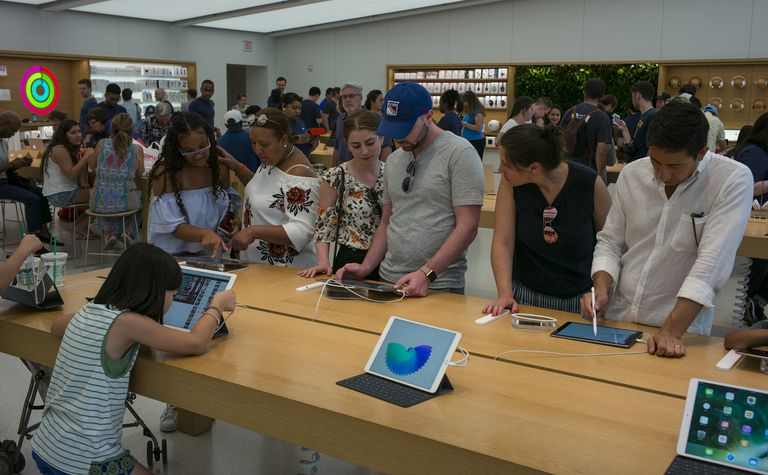 People in Apple retail store