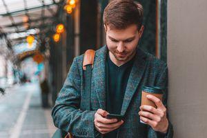 Man using basic cell phone