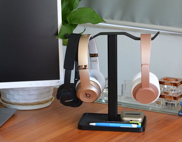 Headphones on headphone stand on desk