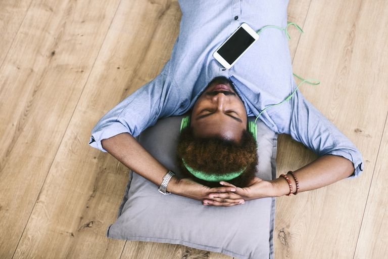 Man lying down listening to music
