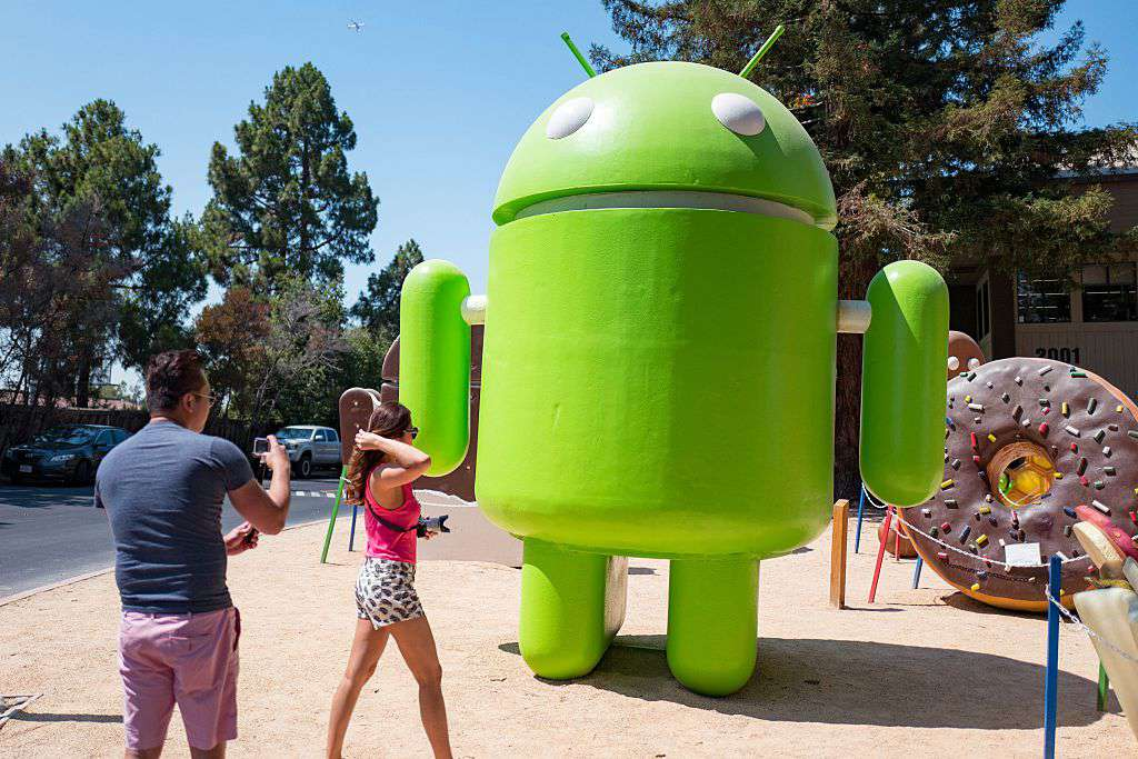 People taking pictures in front of the Android robot at the Googleplex.