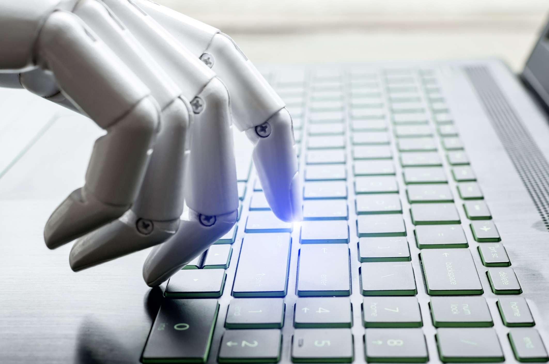 Robot hand pressing computer keyboard enter