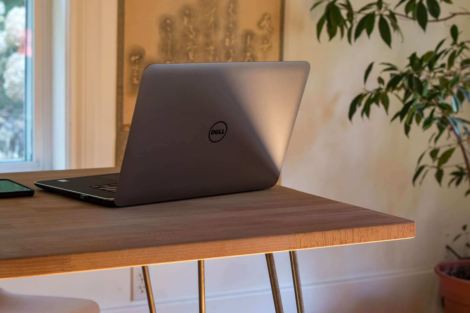 A Dell laptop sits on a desk
