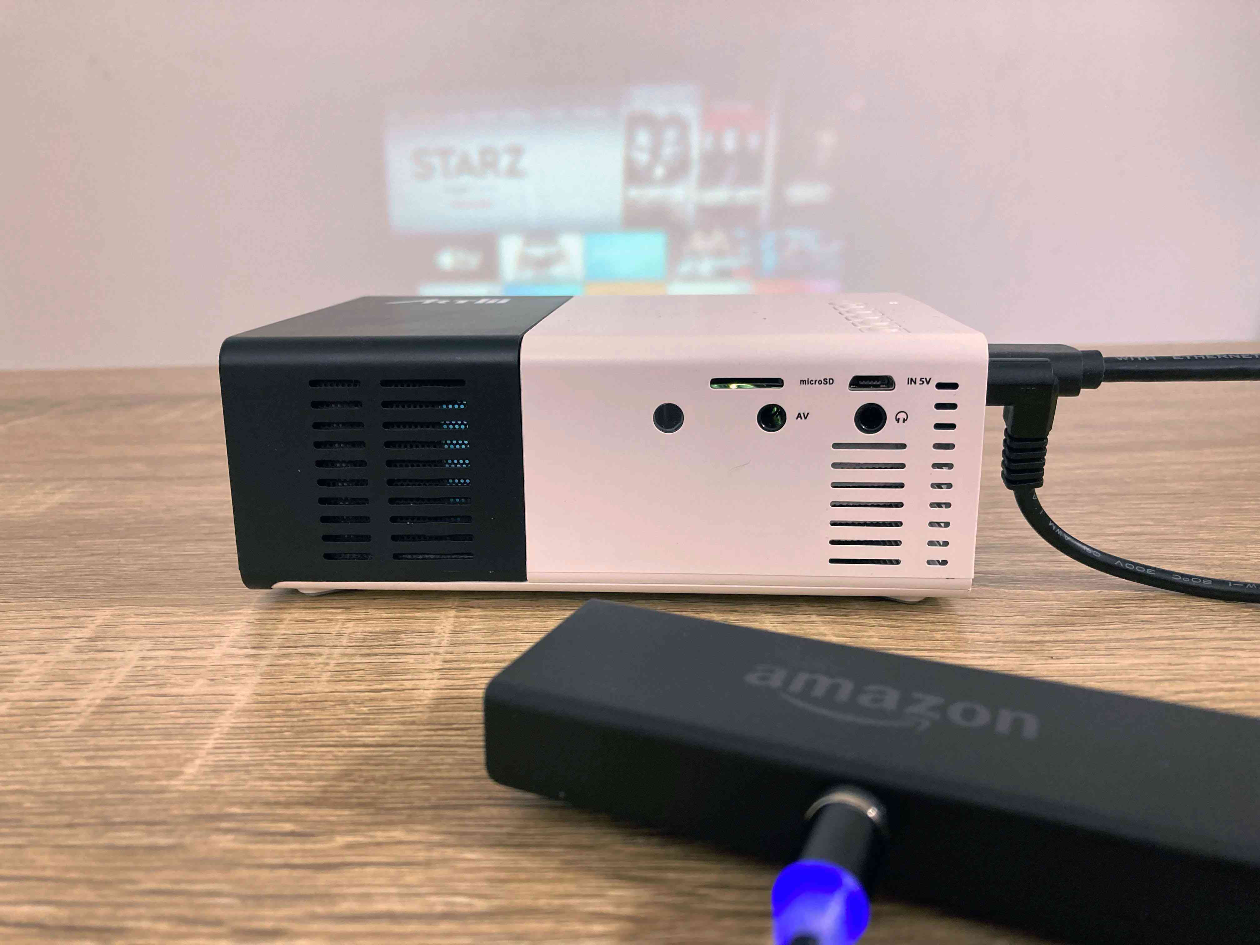 A projector connected to a Fire TV Stick.