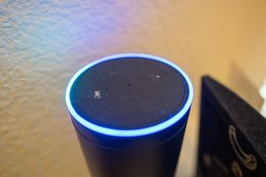 An Amazon Echo with the top lit