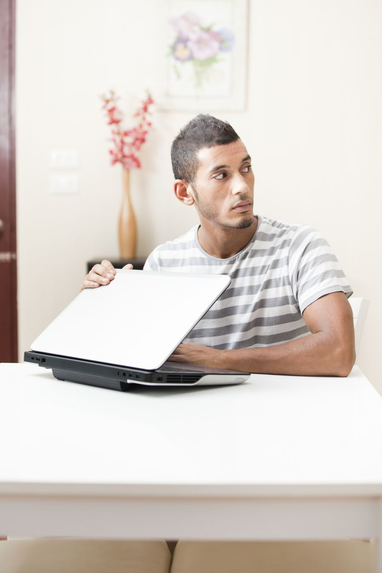 Person hiding laptop screen.