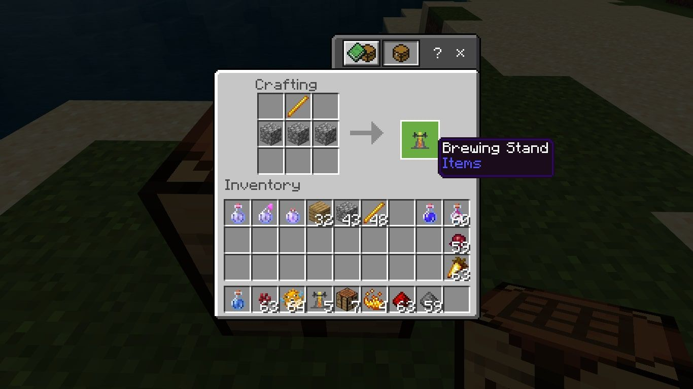 Make a Brewing Stand by placing a Blaze Rod in the middle of the top row and three Cobblestones in the second row.