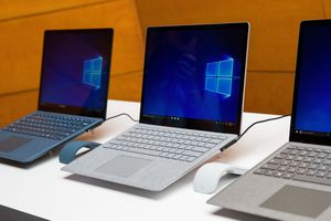 A row of Microsoft Surface computers running Windows 10